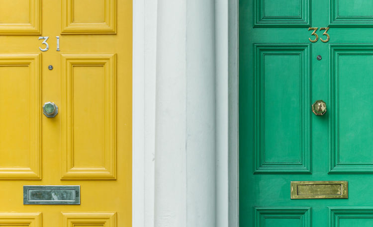 A photo of colourful house front doors.