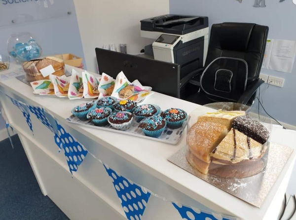 The Thomas Flavell team present cakes for chairty consumption!