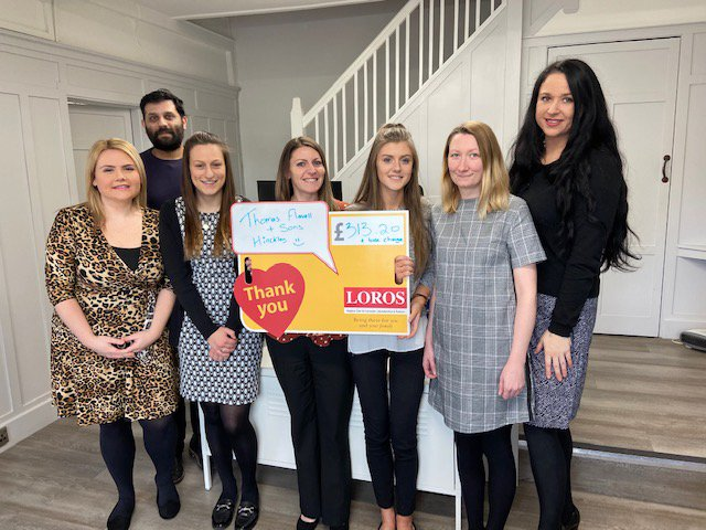 The Thomas Flavell team at Hinckley present their fundraising cheque for Loros